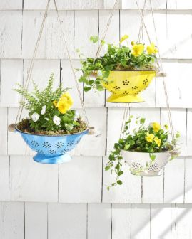 Strainers painted in different colours and hung to create stunning décor Image source: http://www.countryliving.com/gardening/garden-ideas/g2286/10-upcycled-items-that-can-be-repurposed-into-diy-planters/
