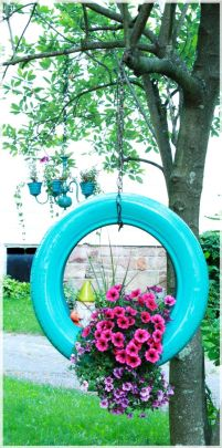 A beautiful turquoise pained tyre hanging from a tree. Notice the contrast with the pink flowers. Image source: http://www.coupons.com/thegoodstuff/15-upcycled-planters/