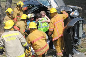Johnson County Ambulance and Vienna Fire Department personnel assist 91-year old Mary Ozment of Marion from a SUV that she was a passenger in when it rolled several times Sunday morning on Rt. 146, at Concord Church Road, east of Vienna. The driver, Phyllis Gulati, 66, of St. Petersburg, Fla. received serious injuries. Gulati was sited for improper lane usage.