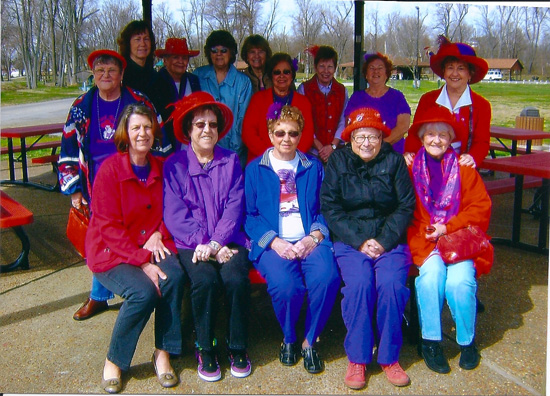 "Several members of the Vivacious Vienna Red Hats, are enjoying the new picnic tables at shelter #1 ""The Eagles"" at the Vienna City Park. Front row from left: Trudy Felcyn, Betty Jones, Norma Martin, Pat Kalicki, Rosemarie Zawacki. Standing from left to right: Rose Harris, Ann Stachowiak, Sandy Belske, Ann Gazor, Esther Speletich, Dolly Hopkins, Barb Jones, Jean Taylor and Donna Kinkade. Picture taken by Lawrence Kinkade"