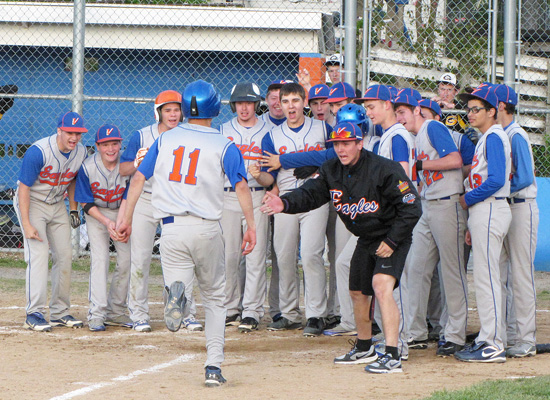 Dallas Bent (#11) is greeted at home plate after his sixth inning, two-run homer gave the Eagles a 2-1 win over Goreville.  (Photos by Patti McGinnis).