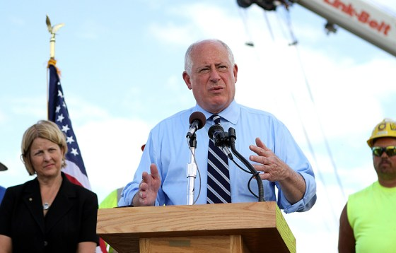 """Illinois Gov. Pat Quinn, along with Illinois Transportation secretary Ann L. Schneider (left), joined state and local officials in Marion Monday afternoon to break ground on a $10.6 million I-57 widening project.  """"This stretch of I-57 near Marion is one of the most critical for drivers in the region,"""" Gov. Quinn said.  """"This project will make getting to work, school or connecting with family easier while bringing jobs and more economic growth to Southern Illinois.""""  The improvements between Marion and Johnston City will include adding a third traffic lane, replacing and widening the I-57 bridges over Lake Creek Branch and other associate work.  According to Quinn, the project is part of his agenda to create jobs and drive Illinois' economy forward and is in addition to $69 million in other road projects underway in the Marion area.  ~ photo by Joe Rehana"""