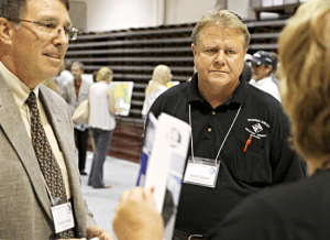 Shawnee Survey and Consulting's Vice President and Chief of Survey Operations Mitchell R. Garrett (center) joins Brooks Brestal (left) of Horner & Shifrin at an I-66 Corridor Study Open House held at Shawnee Community College last week.  Garret's design firm is one of only a handful working on the I-66 project and is the only design firm on the study group hailing from Southern Illinois.