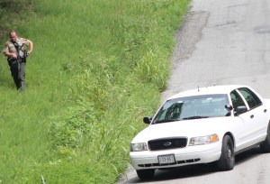 State Troopers were seen early Saturday afternoon with guns at-ready during the long standoff with a Johnson County resident.