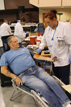 Richard Holland, of Vienna, has his arm sterilized by Red Cross nurse Judy Morris, in preparation of him donating blood Monday at the Vienna Community Blood Drive. Holland and his wife, Patricia, regularly donate blood during the Vienna drives held at Fellowship Baptist Church.