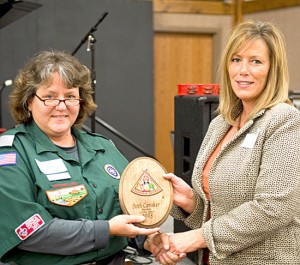 Rookie Cathy Schmidt, left, presents Beth Caraker with her Rookie of the Year Plaque.