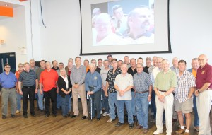 With only five weeks remaining of a lifetime career and completing his fourth decade of service, Johnson County Sheriff Elry Faulkner was honored Saturday by family, friends and fellow law enforcement members.  Elry, pictured above, fifth from left in the front row, is flanked by many of his current and retired law enforcement from across the state during a retirement reception hosted by his wife Mary and daughters Katrina Treat and Debbie Faith at Vienna High School.  Sheriff Faulkner's last day of duty as county sheriff will be November 30, 2014, when he will officially retire the post.  Elry Faulkner is, to date, the longest continuously-serving Illinois sheriff.