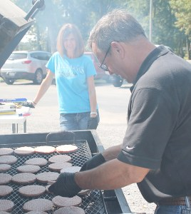 Steve and Pam Shoemaker, local owners of Glass Doctor, prepared hamburgers and hotdogs for nearly eighty local public service employees and volunteers.