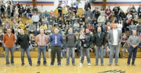 Former VHS basketball coach Rick Metcalf, far right, and former assistant coach Kelly Harper, next to him, stand with a number of former players from the 2004 through 2008 seasons. They are, from left, Chris Nichols, Kyle Willis, Derek Trovillion, Jamie Kerley, Sean Lasley, Corey Huckelberry, Nathan Elms, Matt Ellet and Brett Thompson.