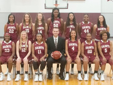 Shawnee Community College Lady Saints basketball team members include, front row from left, Le'Onzerrae Grubbs, Tori Loomis, Lanecion Soward, coach Luke Scheidecker, Koree Simelton, Takena Taylor and Phenicia Howard. Back row, Ariel Johnson, Jami Shipley, Cara Farris, Jesheon Cooper, Emari Jones, LaQuesha Prather and Ryen Hendricks.