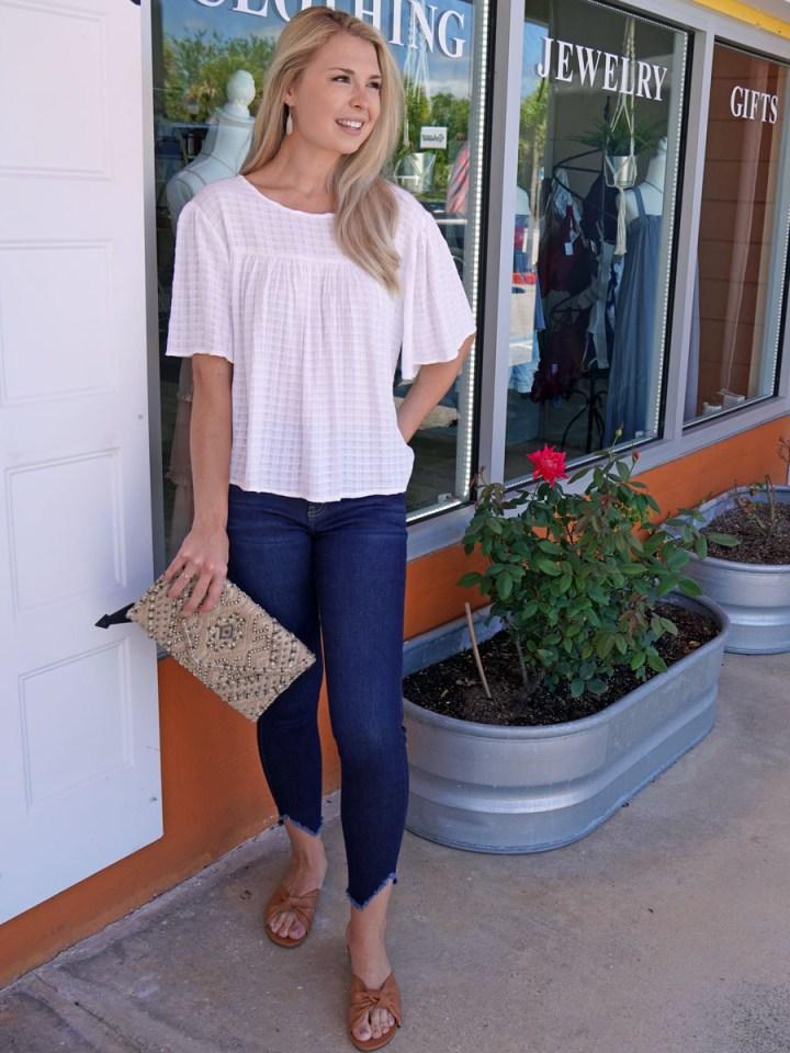 Modeling of the fashion trend, frayed hem jeans.