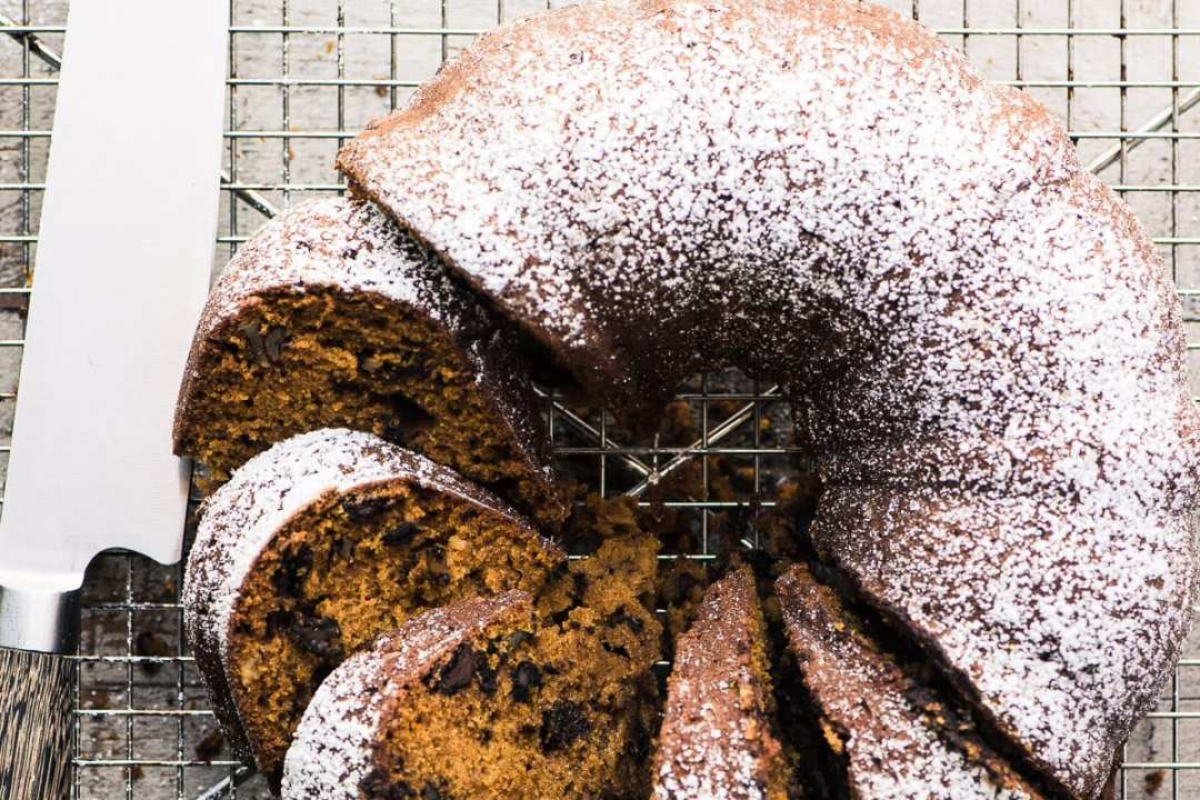 Chocolate Chip Pumpkin Bread, sliced, on a cooling rack