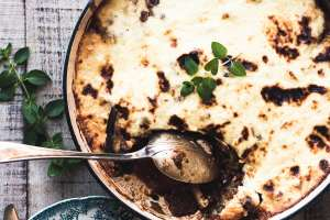 A pan of Moussaka with large spoon