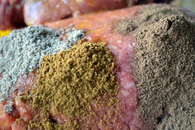 Photo of spices on top of raw ground meat for Lebanese Meatballs.
