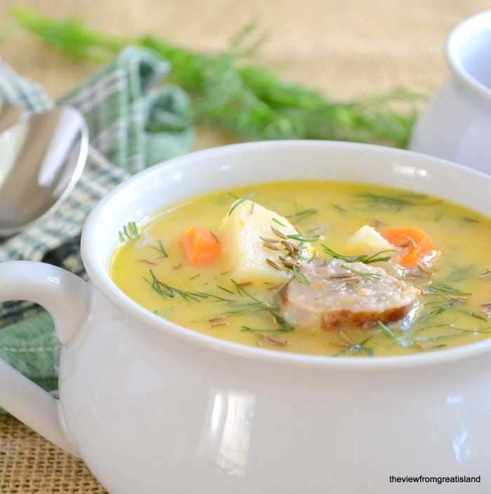 Cheddar and Bratwurst Soup in a white bowl