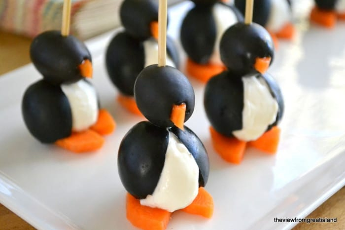 Olive Cocktail Penguins on a white platter with toothpicks