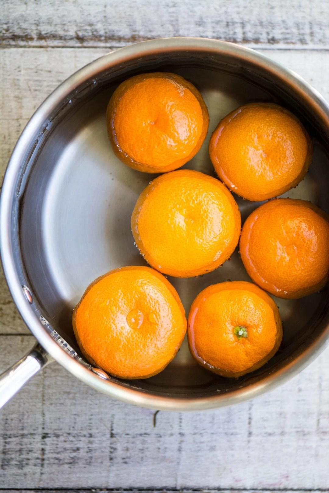 Boiling tangerines for a Gluten Free Tangerine Cake