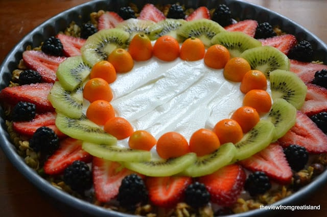 Arranging colorful fruit on a Beautiful Breakfast Tart