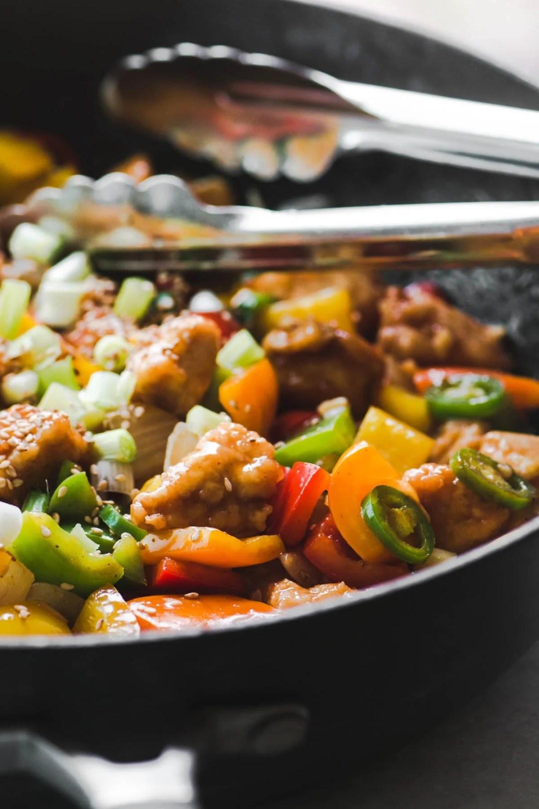 Making Firecracker Chicken at home, in a wok.
