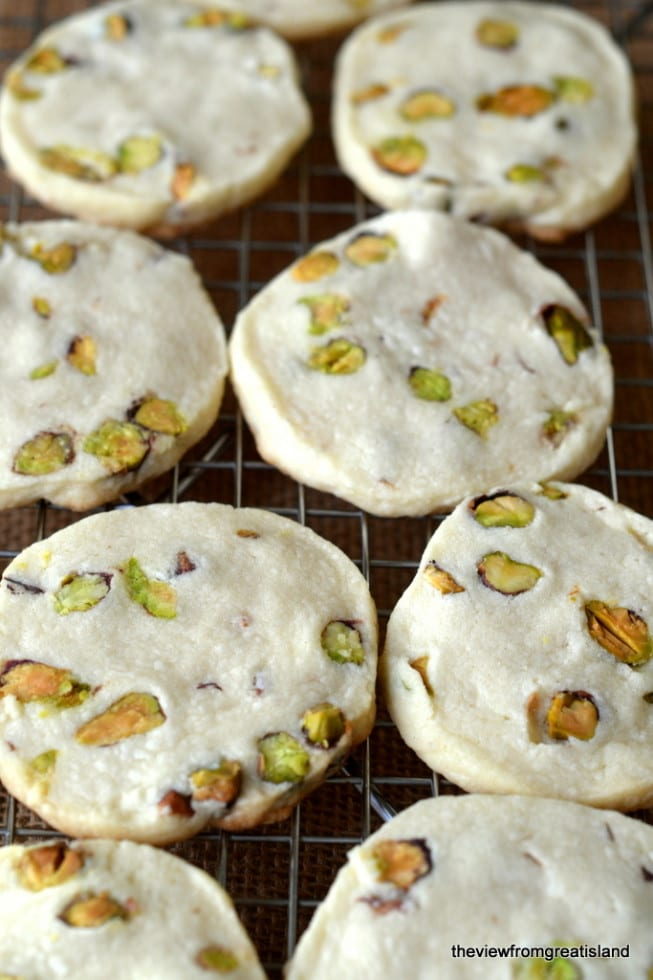 Pistachio shortbread cookies cooling on a rack