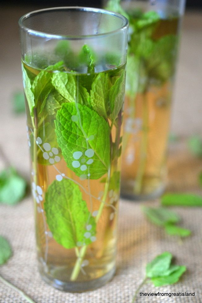 Photo of two glasses of Sweet Moroccan Mint Tea with mint leaves.