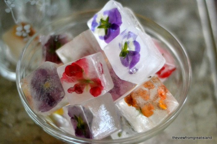 Photo of a bowl of Edible Flower Ice Cubes.