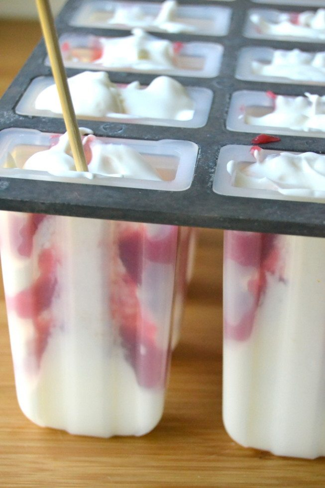 Photo of Rhubarb and Greek Yogurt Popsicles in popsicle molds.