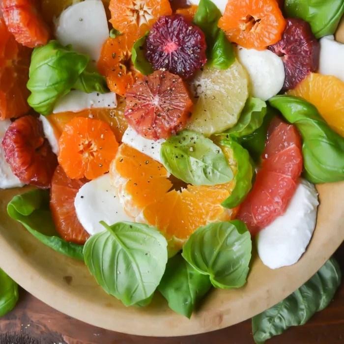 a bowl of citrus caprese salad