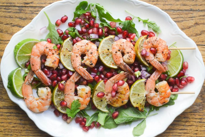 grilled shrimp with pomegranate salsa and greens