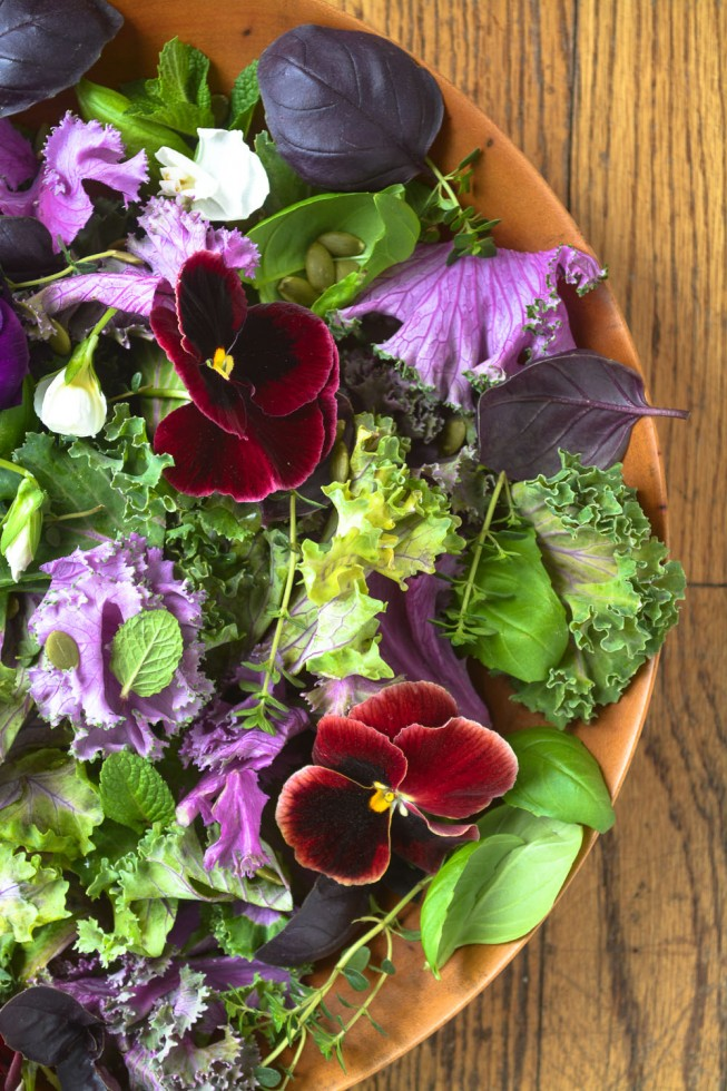 Purple kale with herbs and pansies