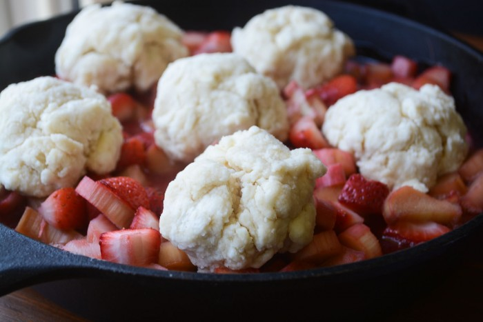 a simple biscuit dough tops a strawberry rhubarb cobbler