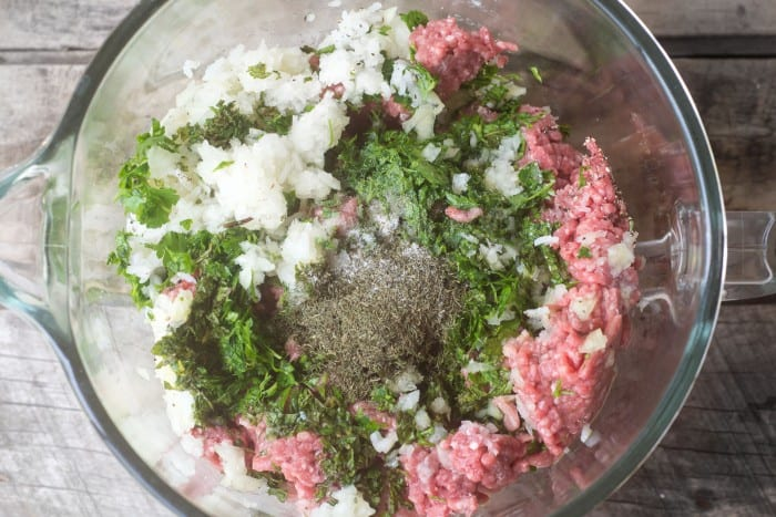 Mixing Greek meatballs