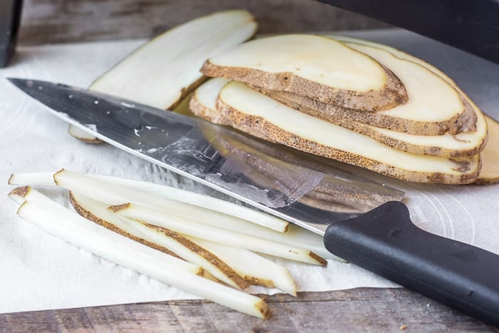 Slicing up russet potatoes for Skinny Fries | theviewfromgreatisland.com