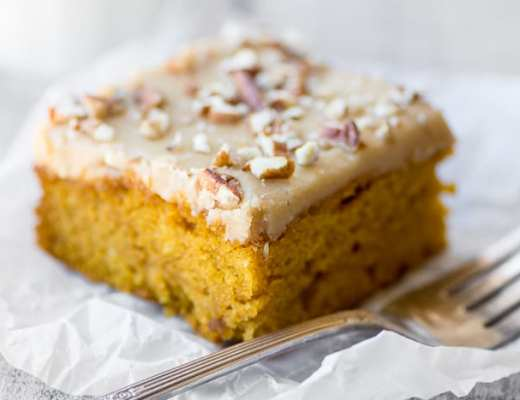 Praline Pumpkin Snack Cake is the ultimate fall treat, with a moist, slightly spiced pumpkin cake topped with a to-die-for praline caramel frosting ~ theviewfromgreatisland.com