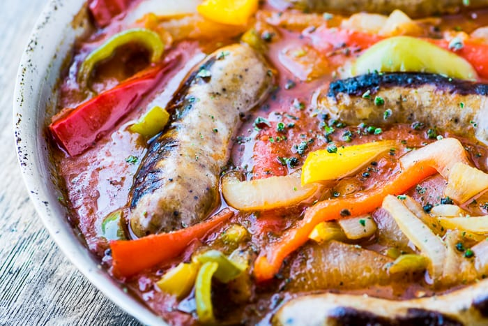 Easy Sausage and Peppers Recipe will get rave reviews every time, it's a comforting family meal that's ready in an hour. | theviewfromgreatisland.com
