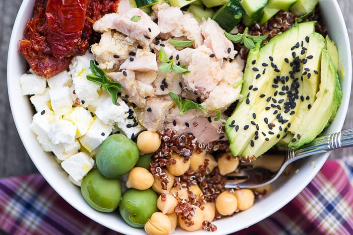 Albacore Buddha Bowl with red quinoa, albacore tuna, cucumber, avocado, olves, feta cheese and chickpeas for a powerhouse meal! ~ theviewfromgreatisland.com