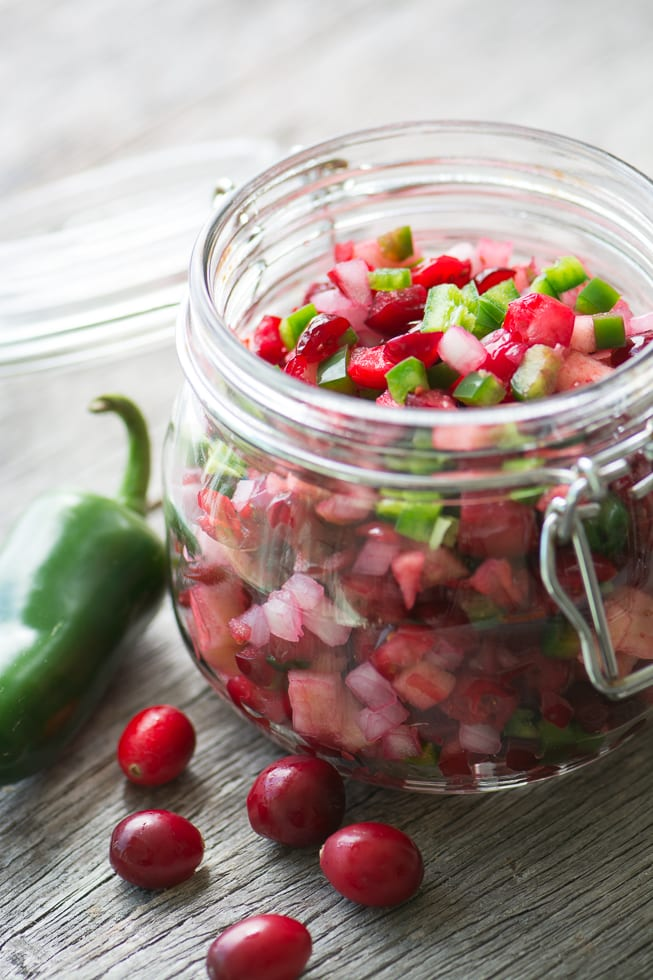 Spicy Cranberry Relish is an irresistible blend of fresh cranberries, crisp apple, onion, and jalapeno ~ theviewfromgreatisland.com