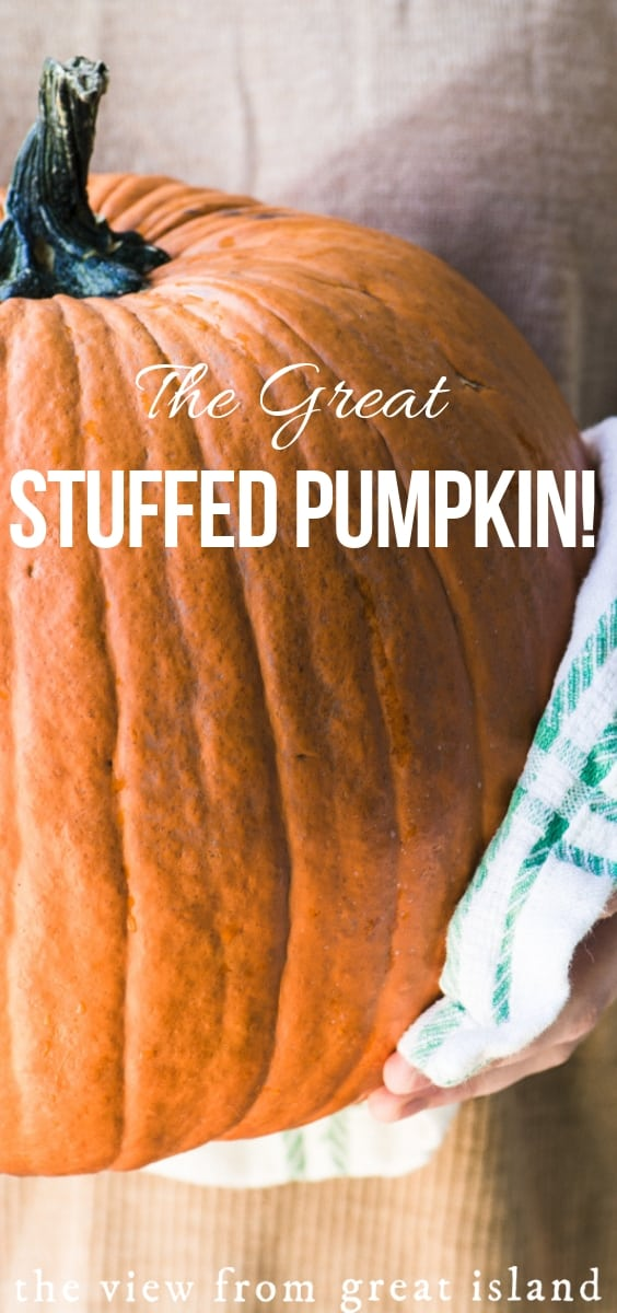 This stuffed pumpkin recipe is a dramatic side dish or vegetarian main course ~ I guarantee it will command center stage on your table. Perfect for Friendsgiving! #vegetarian #vegan #thanksgiving #stuffed #recipe #healthy #pumpkin #sidedish