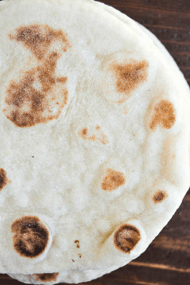 an overhead photo of a piece of pita bread ~ How to make pita bread