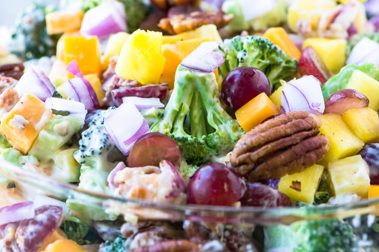 Broccoli Salad with Pineapple, Bacon and Spiced Pecans ~ don't be surprised if everybody skips the main course altogether and heads straight for this salad! This classic broccoli salad is chocked full of juicy fruit and crunchy nuts ~ and don't forget the bacon!