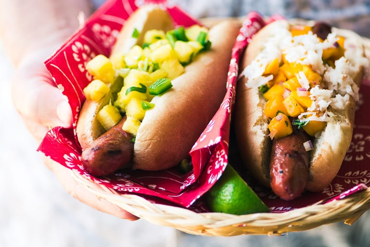 Tropical Hot Dog Bar ~ hot dogs with exotic relishes, salsas, and slaws made with tropical ingredients like coconut, Maui onions, papaya, and mango.