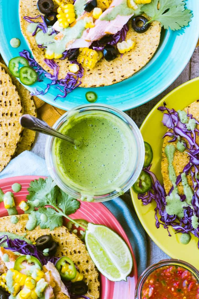 Grilled Salmon Tacos with cilantro crema ~ this casual meal makes life so easy, just set out the tortillas and the fixings, and let people have at it. Everything can be made ahead so by the time the afternoon heat sets in, all you have to worry about is staying cool!