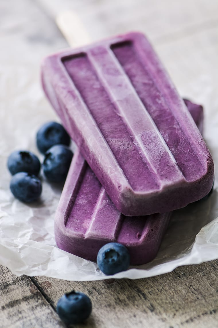 Wild Blueberry and Almond Butter Yogurt Popsicles ~ these vibrant popsicles are made with nonfat yogurt, creamy almond butter, and convenient frozen blueberries for a healthy smoothie on a stick.