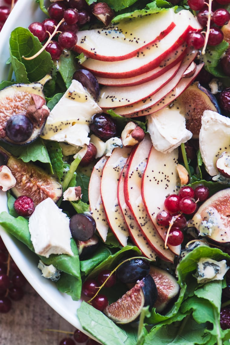 Kale and Fall Fruit Salad drizzled with poppy seed dressing