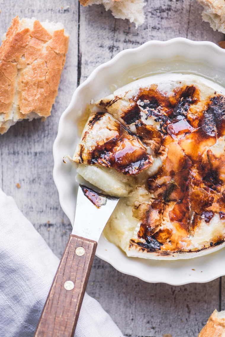 Bruleed Baked Brie with a knife and bread