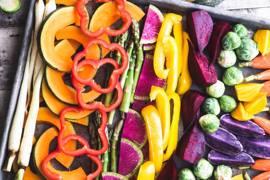 rainbow vegetables in a roasting pan