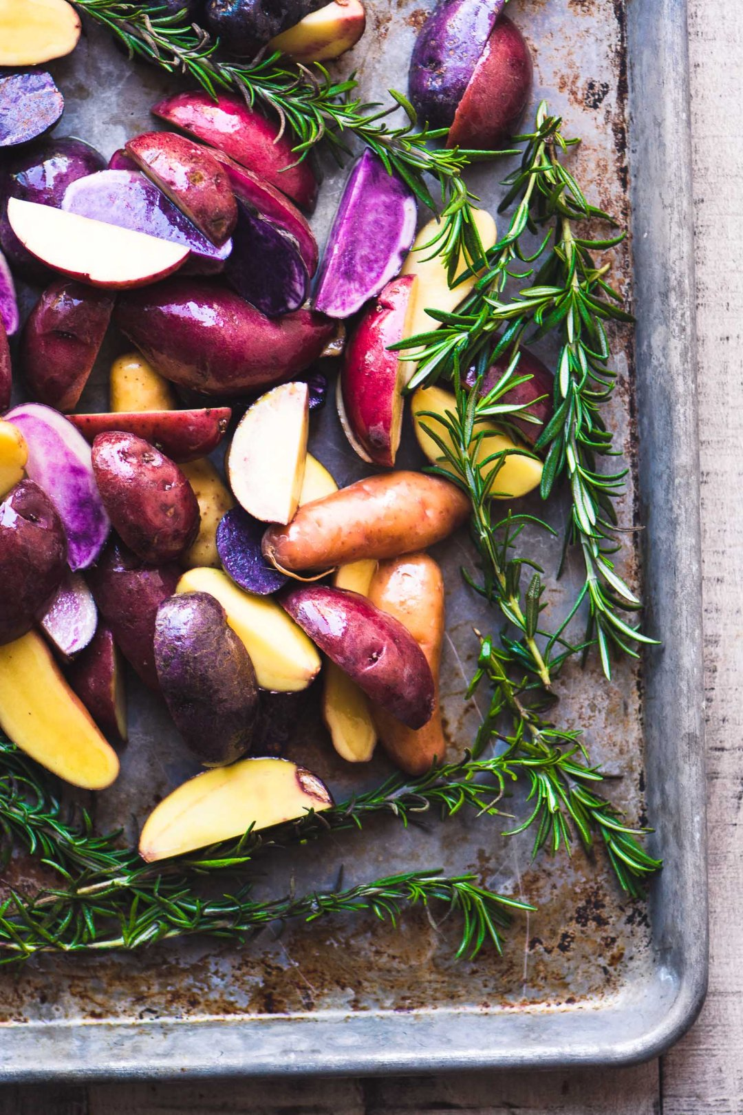 Rosemary roasted rainbow potatoes ion a sheet pan