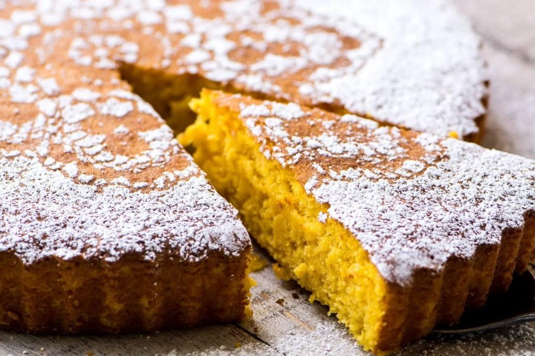 Gluten Free Tangerine Cake with slice taken