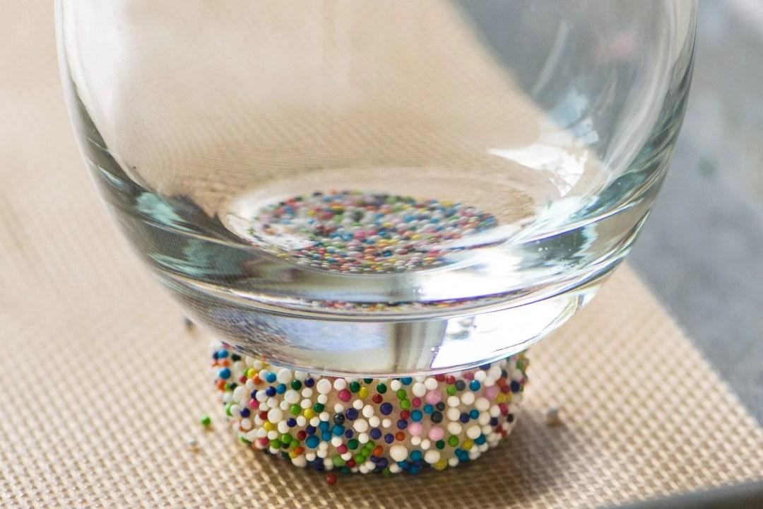Flattening a Sprinkle Sugar Cookie before baking
