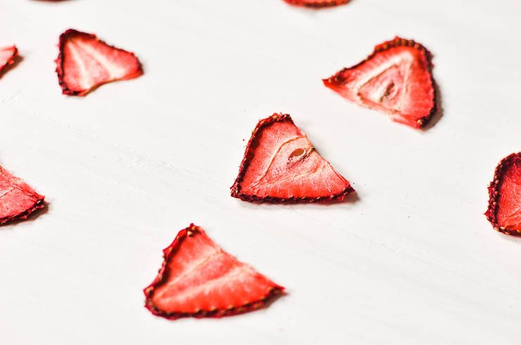 dehydrated strawberries on a white surface